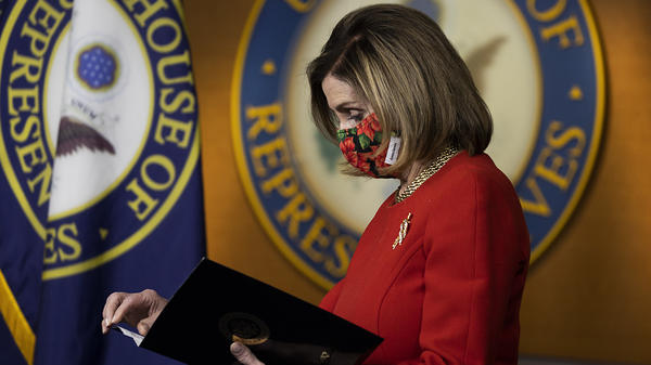 House Speaker Nancy Pelosi, D-Calif., holds a press conference Sunday. Congress is scrambling after President Trump blasted a major aid and spending package that lawmakers passed Monday.