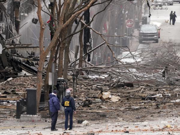 Emergency personnel work near the scene of an explosion in downtown Nashville, Tenn., on Dec. 25.