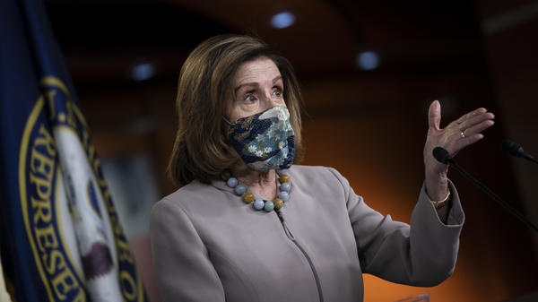 House Speaker Nancy Pelosi, pictured on Dec. 10, led her chamber in a vote to override President Trump's veto of the annual defense bill on Monday.