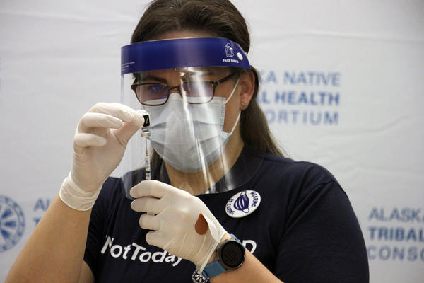 Emily Schubert, the employee health nurse at the Alaska Native Medical Center in Anchorage, Alaska, prepares a COVID-19 vaccine shot on Tuesday, Dec. 15, 2020. Front-line health care workers are among the first in Alaska to receive the vaccine.