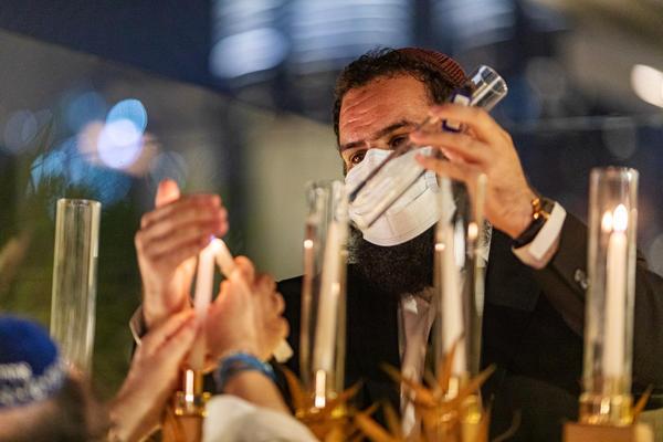 Rabbi Levi Duchman lights a menorah during Hanukkah at a private residence in Dubai, United Arab Emirates, in December.