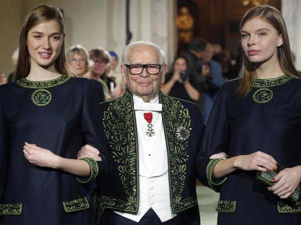 French designer Pierre Cardin has died at age 98. Here, the member of the Académie des Beaux-Arts is seen in 2016, at the end of a fashion show marking 70 years of his creations at the Institut de France in Paris.