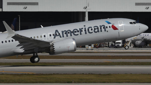 American Airlines Flight 718, a Boeing 737 Max, takes off Tuesday from Miami International Airport on its way to New York — the plane's first commercial flight in the U.S. since it was allowed to return to service. The 737 Max was grounded worldwide after two crashes due to a faulty flight system.