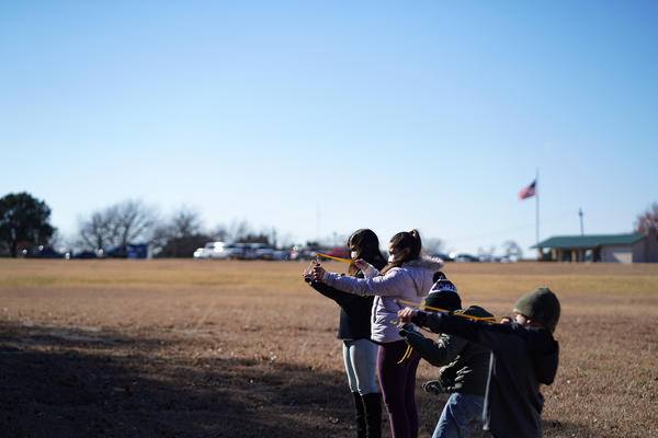 "Kids participate in a ""sling-shot"" activity at Camp Wisdom, during the Cub Scouts ""Chill-O-Ree"" event in December."