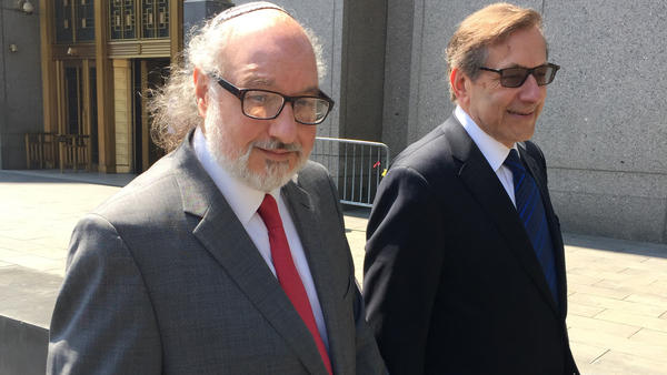 Convicted spy Jonathan Pollard, left, with his lawyer, Eliot Lauer, leaves federal court in New York following a 2016 hearing. The former U.S. Navy analyst who spent three decades in prison after pleading guilty to spying for Israel, has arrived in Israel a month after the Justice Department allowed his parole to expire.