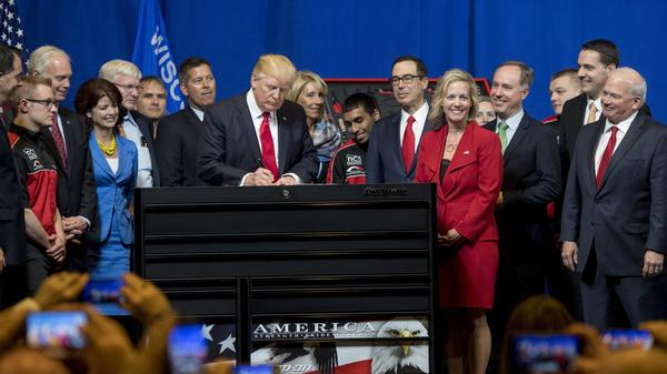 "President Trump signs a ""Buy American, Hire American"" executive order at Snap-On Tools in Kenosha, Wis., in 2017."