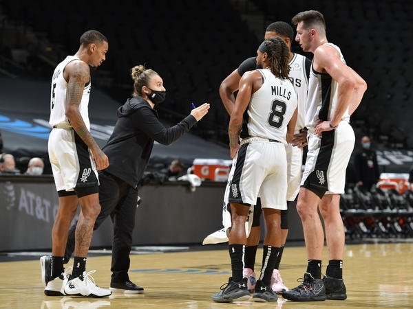 San Antonio Spurs assistant coach Becky Hammon made NBA history Wednesday, becoming the first woman to lead a team in the regular season. She's seen here talking to her players as they faced the Los Angeles Lakers at the AT&T Center in San Antonio.