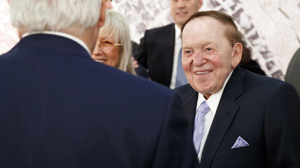 Sheldon Adelson, with his wife, Miriam, talks with then-Secretary of State Rex Tillerson before a 2017 speech by President Trump at the Israel Museum in Jerusalem.