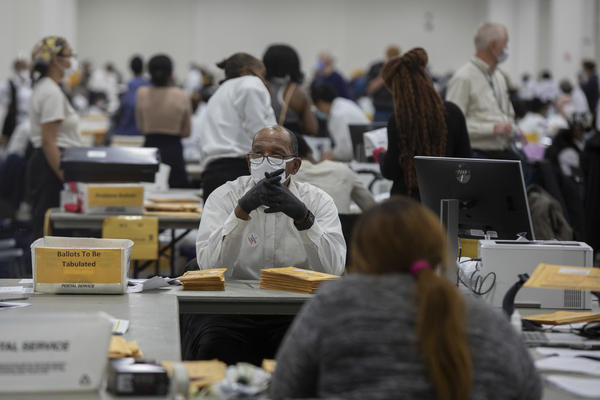 A worker with the Detroit Department of Elections waits for the next absentee ballot to be sorted through at the Central Counting Board in the TCF Center on Nov. 4.