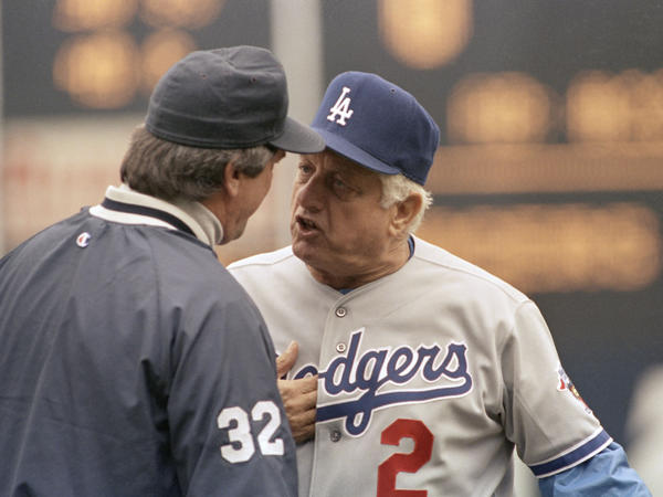LA Dodgers manager Tommy Lasorda argues a call with an umpire during a game against the New York Mets in 1992. During his two decades as manager, Lasorda led Los Angeles to two World Series championships.