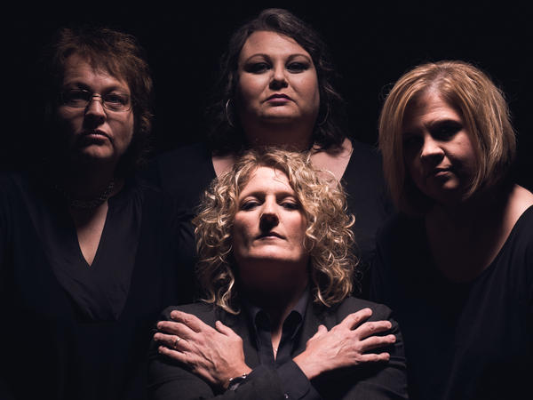 Dale Ann Bradley (left), Tina Adair, Gena Britt and Deanie Richardson (center) of the bluegrass band Sister Sadie do their impression of the rock band Queen.