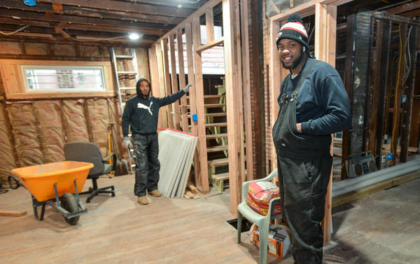 Jeremiah Crow, right, pauses with his business partner A.J. Carson at a Benton Blvd. house they are transforming into a duplex.