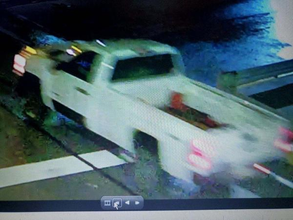 Police are looking for a white truck in connection with an incendiary device thrown from a moving vehicle, which damaged a parked car Sunday night in Pittsburgh's Lawrenceville neighborhood.