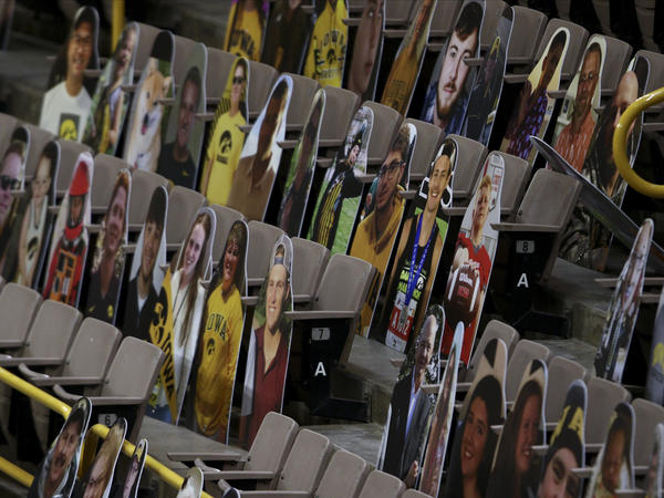 The NCAA says it hasn't decided on whether any fans will be allowed to watch the men's basketball tournament, which will center on Indianapolis. Here, cardboard placards populate Iowa's Carver-Hawkeye Arena last month.