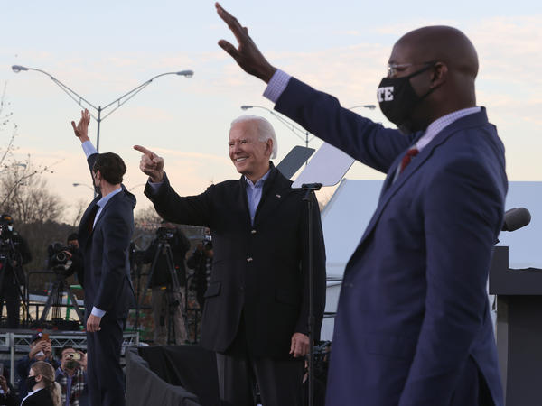 President-elect Joe Biden campaigns alongside Democratic Senate candidates Jon Ossoff (left) and the Rev. Raphael Warnock on Monday in Atlanta.