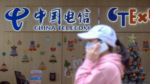 The New York Stock Exchange is backing off plans to delist shares of three Chinese companies, including China Telecom Corp. One of the company's stores is seen here in Hong Kong on Monday.