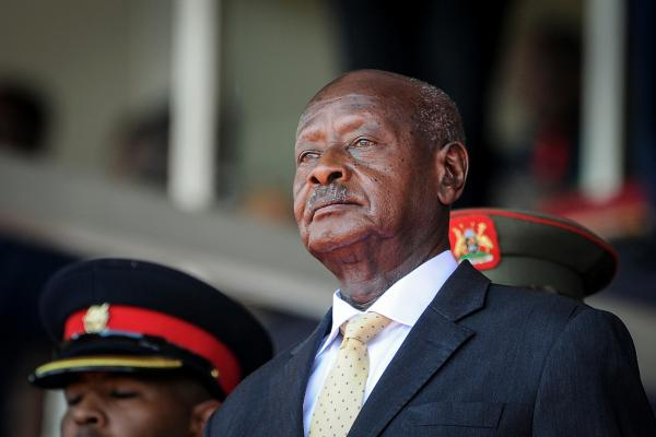 """Uganda's President Yoweri Museveni has been in power since 1986. His police chief has warned that anyone causing trouble on election day """"will regret being born."""" Museveni is facing a formidable electoral challenge from Bobi Wine, who has been arrested multiple times and said Tuesday that the military had killed his driver and that his home was raided."""