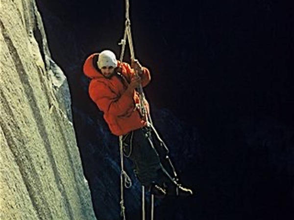 This photo by climbing partner Wayne Merry and provided by the Whitmore Family Trust shows George Whitmore dangling off an outcropping during the historic first ascent of El Capitan in Yosemite National Park in 1958.