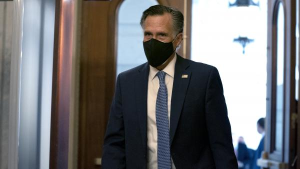 """President Trump has disrespected the American voters, has dishonored the election system and has disgraced the office of the presidency,"" Sen. Mitt Romney told reporters Wednesday. Here Romney arrives at the U.S. Capitol last month."