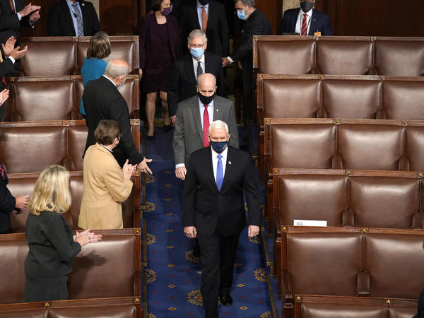 Vice President Pence arrives Wednesday at the joint session of Congress to ratify President-elect Joe Biden's election win.