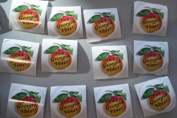 Stickers for voters after they have voted, sit on a table at a Cobb County voting location in Atlanta, Georgia.