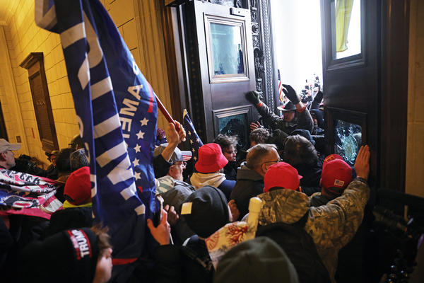 Protesters supporting President  Trump break into the Capitol on Wednesday. D.C. Mayor Muriel Bowser has ordered a citywide curfew starting at 6 p.m. Wednesday.