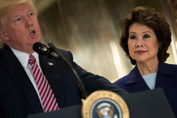 Transportation Secretary Elaine Chao looks on as President Donald Trump speaks following a meeting on infrastructure at Trump Tower in August 2017.