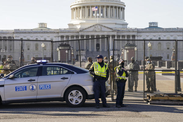 Fencing is placed around the exterior of the Capitol grounds on Thursday, the day after pro-Trump rioters stormed the building. Lawmakers from both parties have criticized the U.S. Capitol Police's response to the security breach.