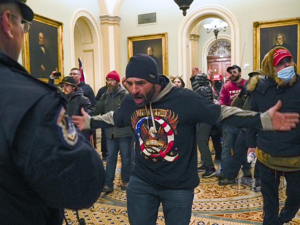 Pro-Trump extremists outside the U.S. Senate chamber Wednesday after forcing their way inside the Capitol.