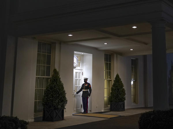 A Marine stands outside the entrance to the West Wing of the White House, signifying President Donald Trump is in the Oval Office, on Thurs., Jan. 7, 2021.