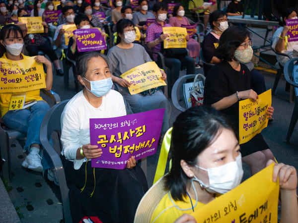Hundreds of people gather for a rally to mark the International Memorial Day for Comfort Women on August 14, 2020 in Seoul, South Korea. A South Korean court recently ordered Japan to financially compensate 12 women forced into sexual slavery by the Japanese.