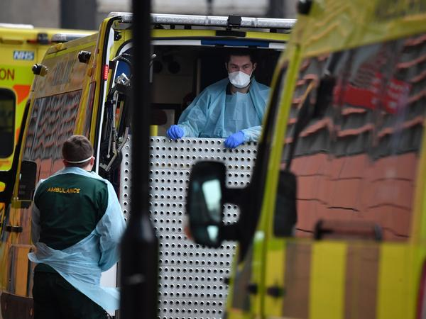 "Paramedics prepare an ambulance outside the Royal London Hospital on Friday. Mayor Sadiq Khan has declared a ""major incident,"" warning that hospitals in the British capital could soon be overwhelmed after a surge in coronavirus infections."