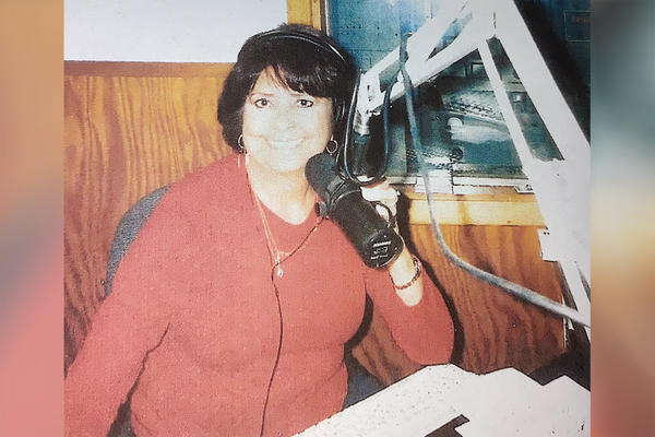 May Bunjes at KFTM in Fort Morgan, Colorado, around 2008. After Bunjes's brother died, she took his Spanish program, working the airwaves for six years.