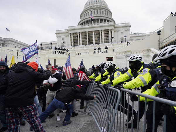Trump supporters try to break through a police barrier on Wednesday at the U.S. Capitol in Washington.