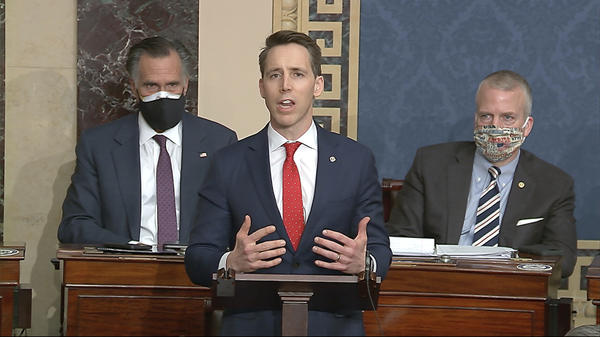Sen. Josh Hawley, R-Mo., speaks during a Senate debate on whether to confirm the Electoral College vote, after protesters stormed the U.S. Capitol on Wednesday.
