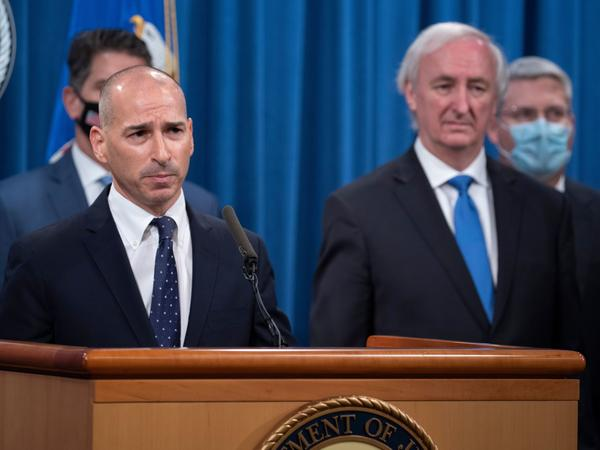 The acting U.S. attorney for the District of Columbia, Michael Sherwin (left), is overseeing the massive criminal investigation of Wednesday's assault on the U.S. Capitol.