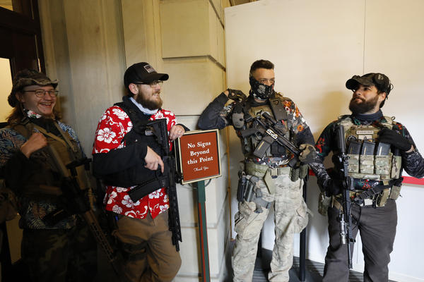 Armed protesters congregate at the Michigan State Capitol in Lansing on Oct. 17. On Monday, the Michigan State Capitol Commission voted to ban open carry in common areas of the building.