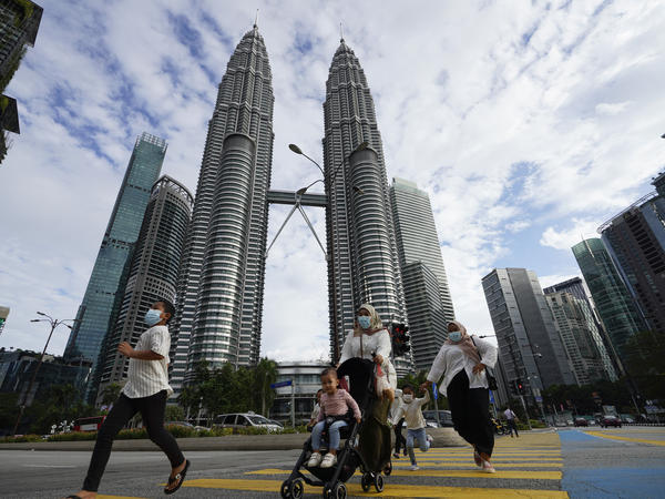 Malaysia's king suspended the national parliament and state legislatures for an unspecified period of time under the nation's new virus restrictions.