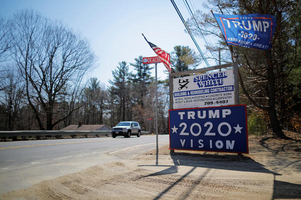 A sign supporting President Trump stands on the roadside last year in Troy, N.H.