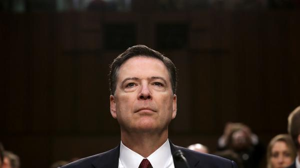 """Former FBI Director James Comey, here in 2017, says he was """"sickened"""" by last week's attack on the Capitol."""