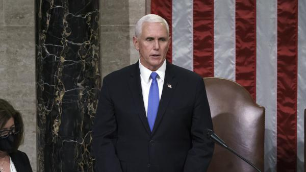 Vice President Pence reads the final certification of Electoral College votes cast in November's presidential election during a joint session of Congress early on Jan. 7.