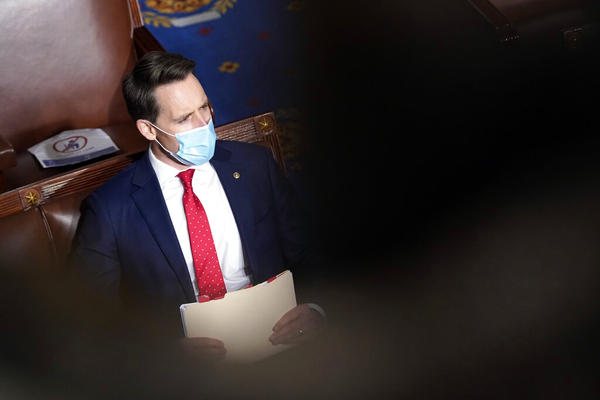Sen. Josh Hawley, R-Mo., walks into the House chamber before a joint session of the House and Senate convenes to count the electoral votes cast in November's election, at the Capitol, Wednesday, Jan 6, 2021. (AP Photo/Andrew Harnik)