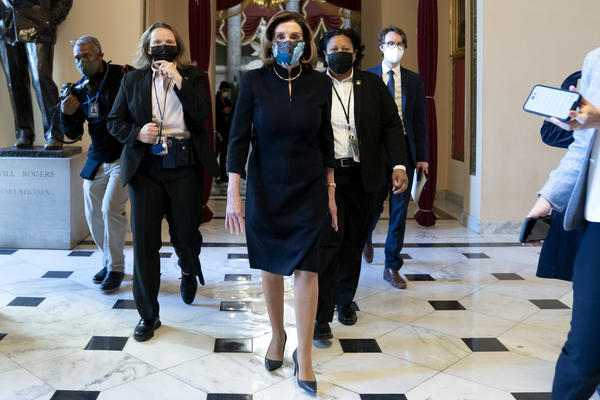 "House Speaker Nancy Pelosi, D-Calif., said that impeaching President Trump is ""a constitutional remedy that will ensure that the republic will be safe from this man."" She's seen here walking to the House floor Wednesday ahead of the vote."