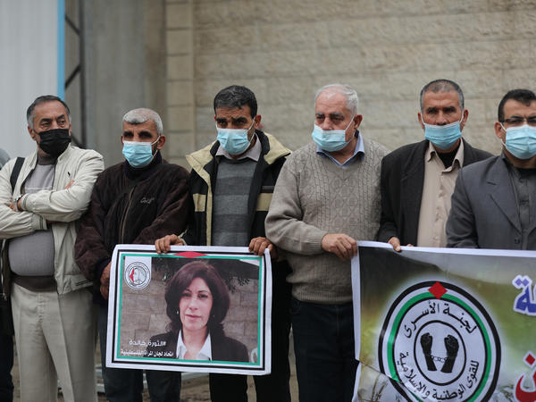 Members of the Palestinian Prisoner Society stage a demonstration outside the International Committee of the Red Cross building, demanding the World Health Organization put pressure on Israeli authorities to vaccinate Palestinian prisoners in Israeli jails, earlier this month in Gaza City.