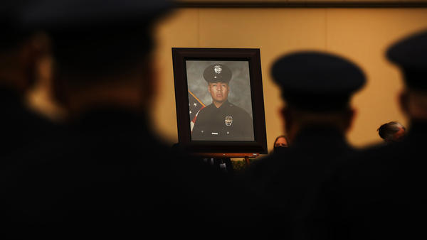 Colleagues, family and friends attend the August funeral of Los Angeles police Officer Valentin Martinez, the agency's first sworn officer to die of complications from COVID-19.