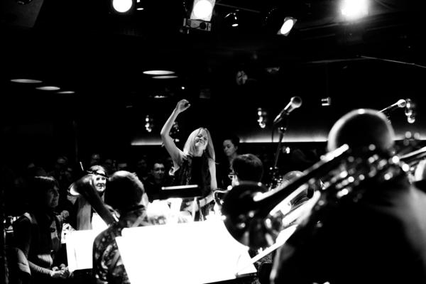Maria Schneider (center) whose album <em>Data Lords</em> was one of 2020's most acclaimed jazz albums, performs with her orchestra at the New York City club Jazz Standard, where the group had an 16-year annual Thanksgiving week performance that was interrupted by the Covid-19 pandemic.