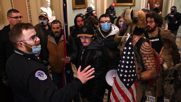 "Jacob Chansley, the ""QAnon Shaman"" known for his painted face and horned hat, was taken into custody in Arizona in connection with the assault on the U.S. Capitol on Jan 6."