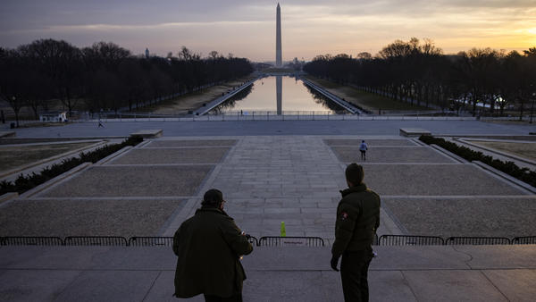 "U.S. park rangers look at the spot where the Rev. Martin Luther King Jr. gave his famous ""I Have a Dream"" speech on the steps of the Lincoln Memorial in Washington, D.C., on Friday. Security threats have prompted officials to shut down the National Mall and much of downtown Washington, D.C."