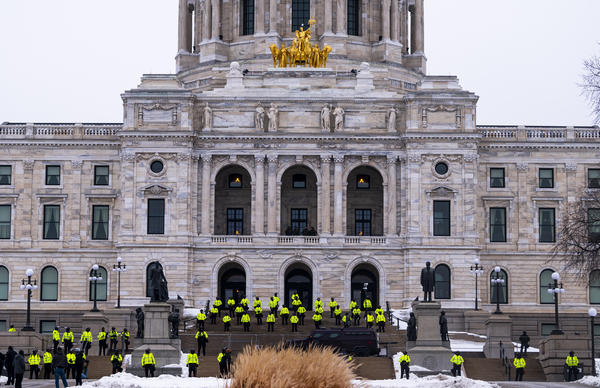 Minnesota State Patrol stand guard outside the Minnesota Capitol building on Sunday in St Paul, Minnesota.