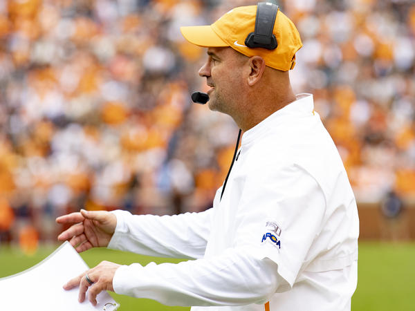 University of Tennessee head football coach Jeremy Pruitt directs players at a game on Oct. 12, 2019. University officials announced they will fire Pruitt and nine football team staff members after an investigation found a slew of likely NCAA violations.